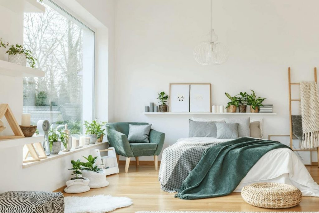 modern bedroom decor featuring various indoor plants and large window