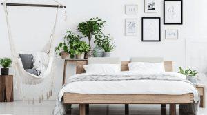 relaxing bedroom sanctuary plants hammock and platform bed