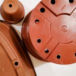 group of plastic and terracotta plant pots with drain holes